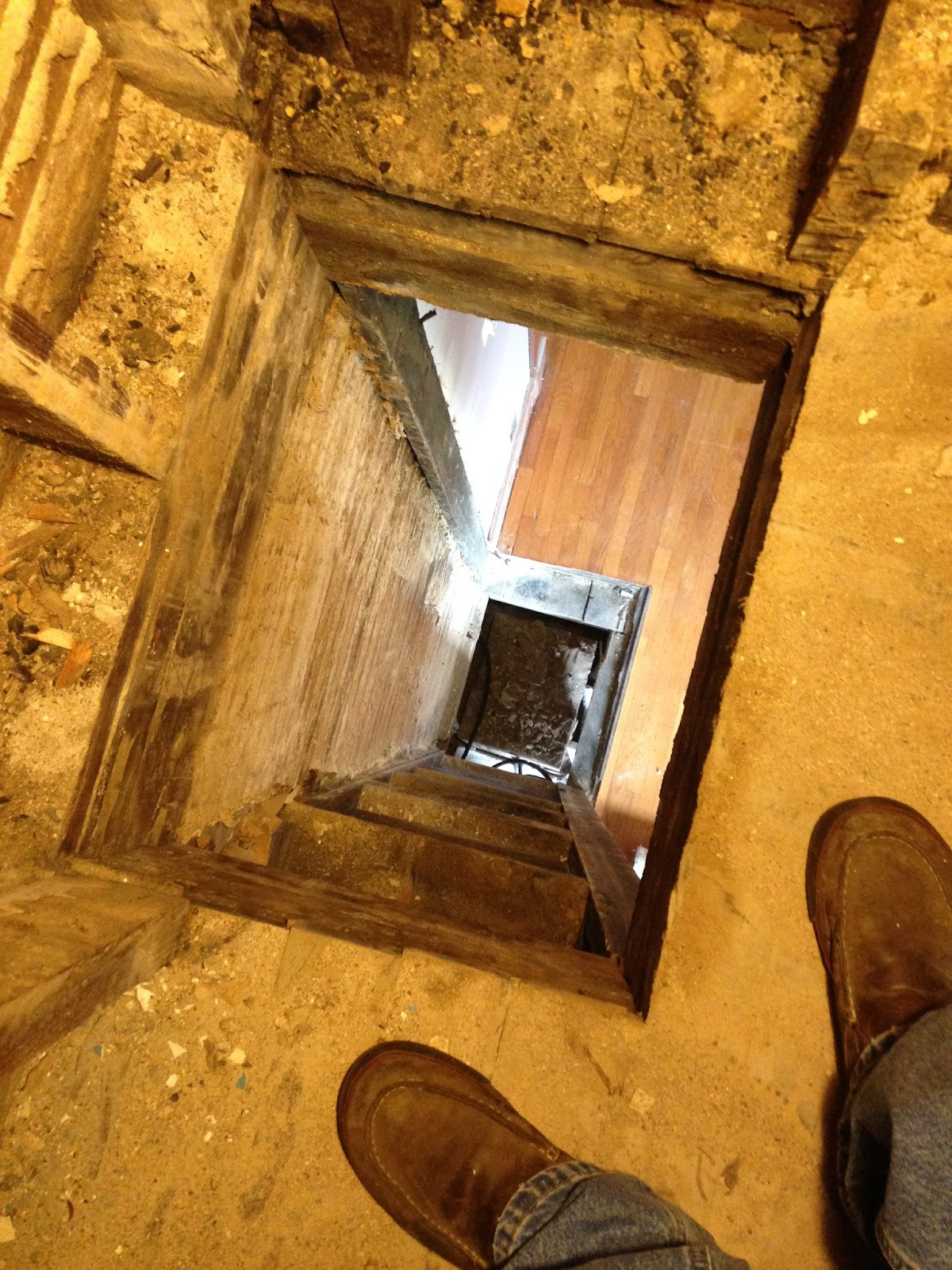 looking down the chimney hole from the second floor through the
