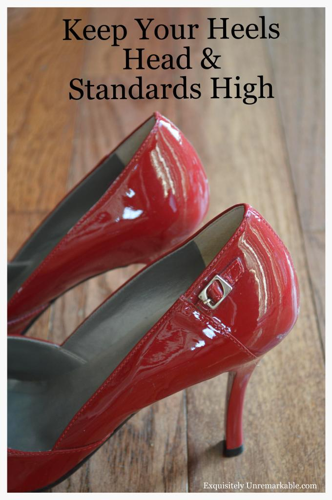 Keep Your Heels Head & Standard High text on photo of Red heels on wood floor
