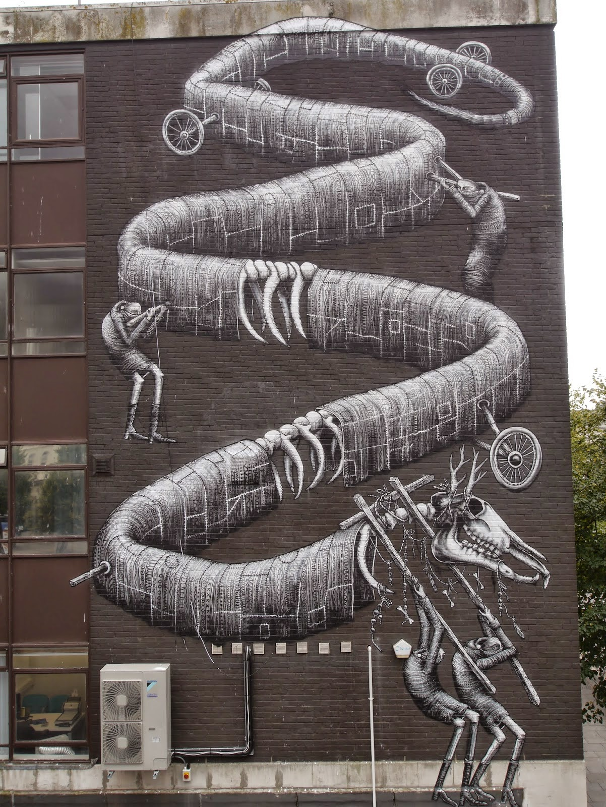 Phlegm is currently in South Wales where he just wrapped up this massive mural somewhere on the streets of Cardiff.