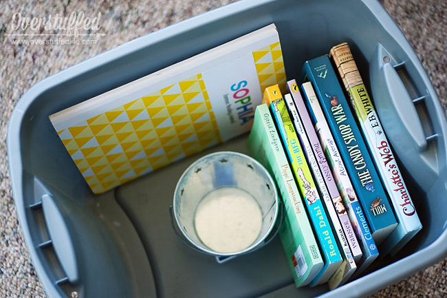 Fill a bin with books, a reading journal, and a way to motivate your children to read this summer.