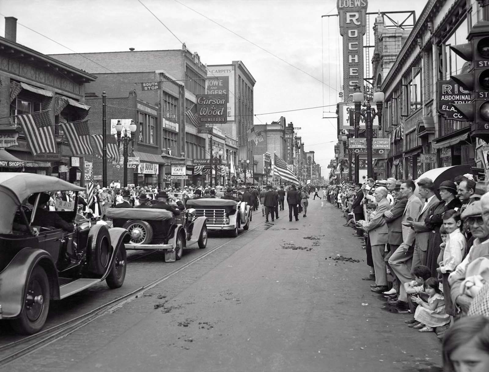 Rochester, New York — The Grand Army of the Republic Civil War Veterans join a parade down main street during Rochester's centennial. 1934.