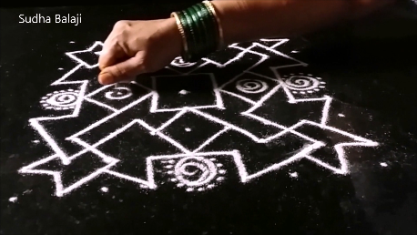 9 dots rangoli-1at.png