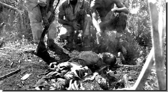Dead Japanese Soldier Surrounded by American Soldiers