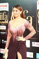 Hansika Motwani in Glittering Deep Neck Transparent Leg Split Purple Gown at IIFA Utsavam Awards 42.JPG