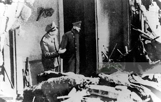 Allegedly the last picture of Adolf Hitler before he committed suicide on . Hitler (right) and his adjutant Julius Schaub looking at the ruins of the Reich chancellery, April 28, 1945.