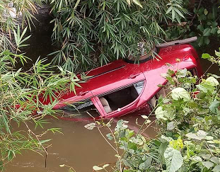 Photos: Vehicle carrying family plunges into a river in Imo State