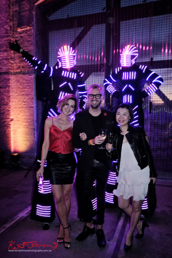 Light robot stilt walkers and Vanessa Christopher and Vivienne. UE Boom 2 Launch at Carriageworks Sydney #PartyUp photographed by Kent Johnson for Street Fashion Sydney.