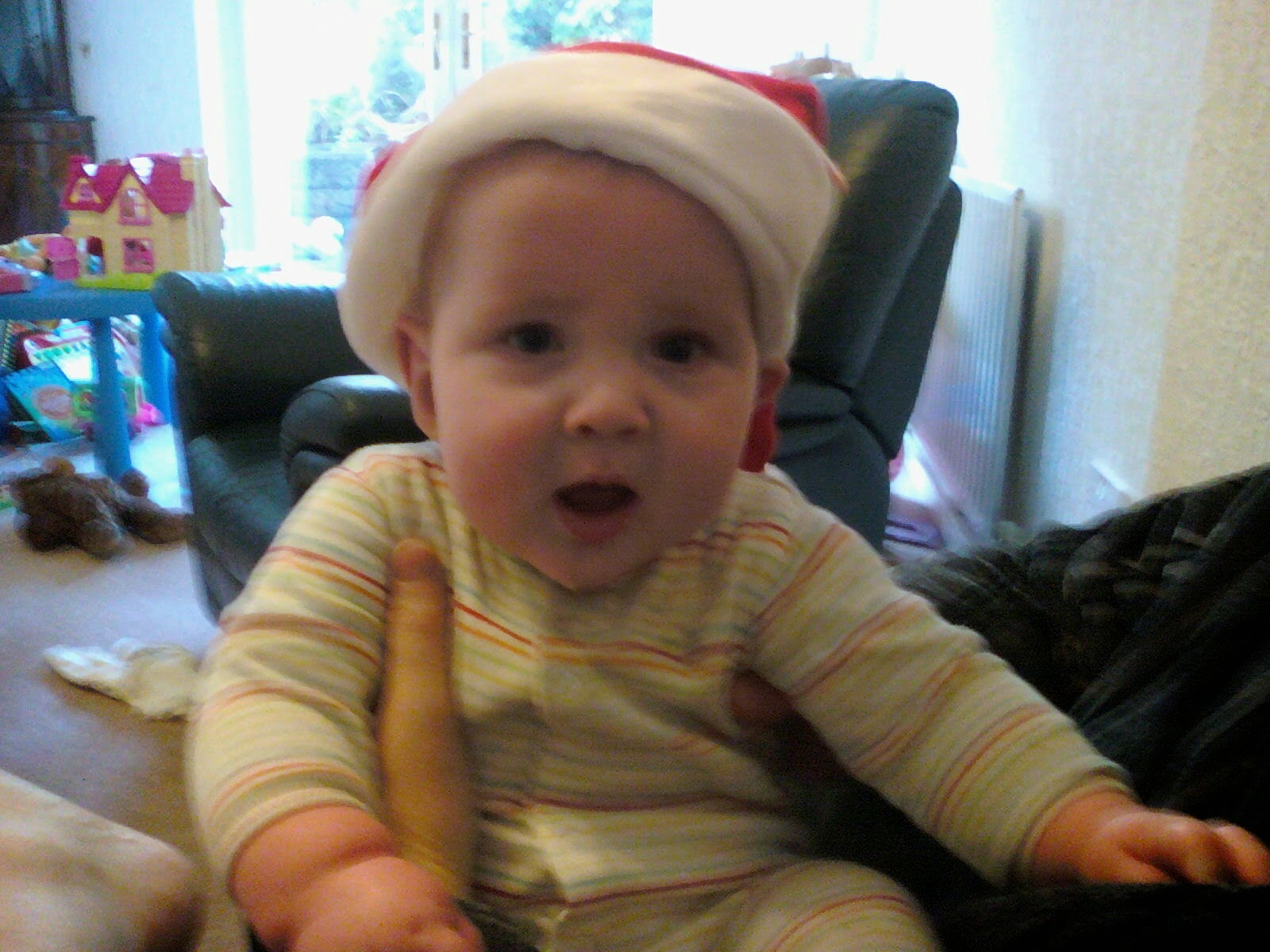 Baby Ieuan in his Christmas hat in 2009