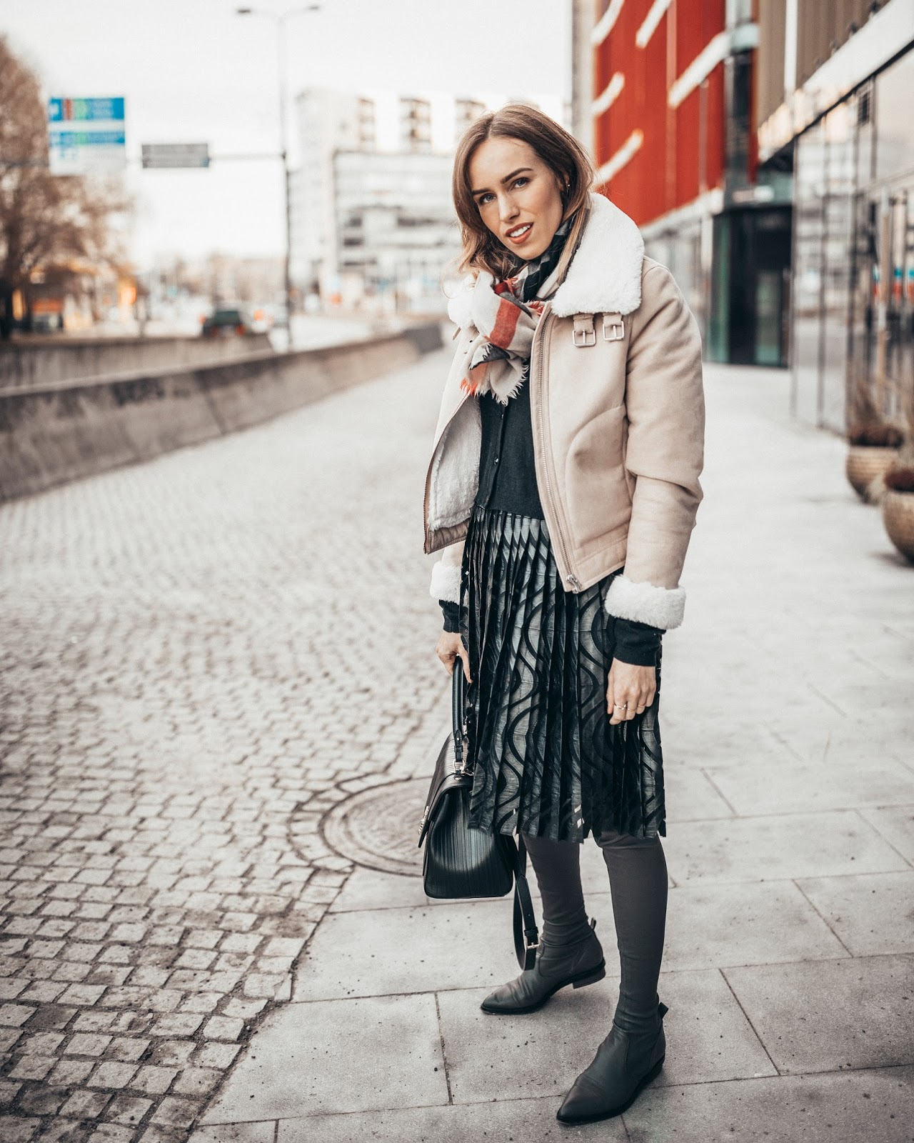 shearling jacket pleated skirt winter outfit street style