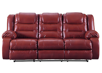 Bright red reclining sofa