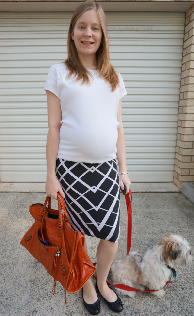 Black and white third trimester office outfit with bright orange handbag