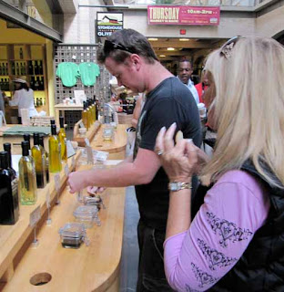 Tasting Olive Oil at Farmers' Market San Francisco California