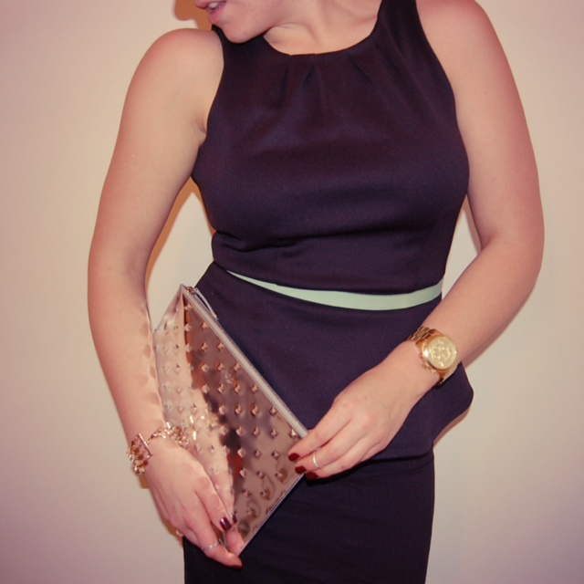 Peplum top with a pencil skirt, mint belt and an Ela Mirror Ball clutch