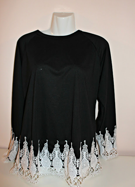 http://www.fashionmia.com/Products/round-neck-decorative-lace-long-sleeve-t-shirt-163277.html