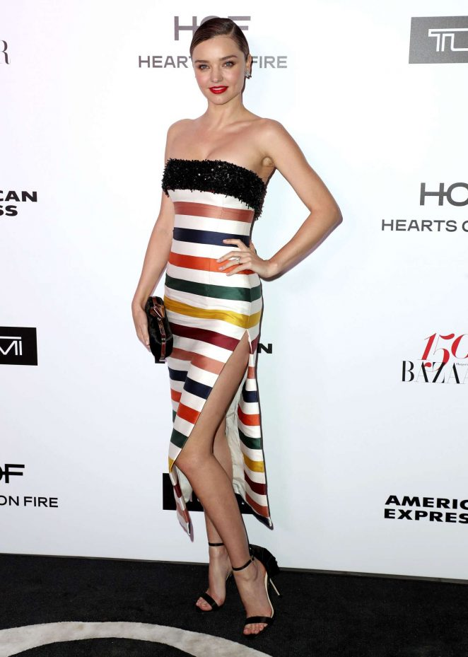 Miranda Kerr smoulders in strapless multicolour gown at the Harper's Bazaar event in LA