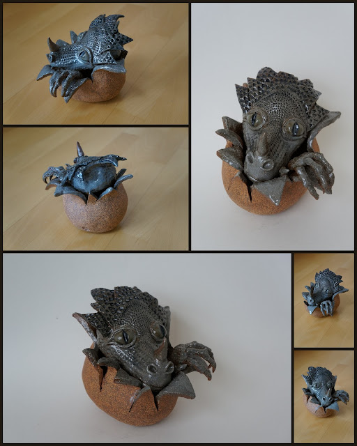 Ceramic / stoneware dragon hatching from an egg, by Lily L.