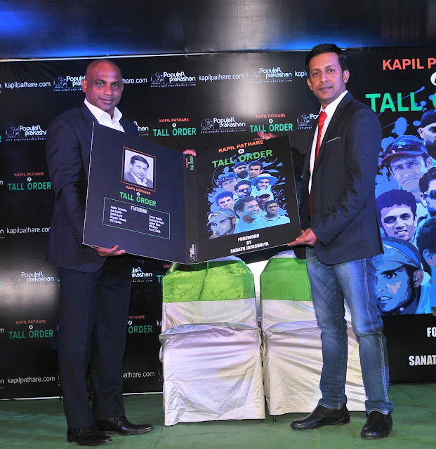 3.Sanath Jayasuriya unveiling the book along with  Kapil Pathare