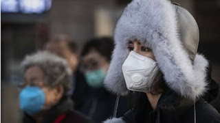 A woman wearing protective mask in Beijing, China. Image source: BBC World News