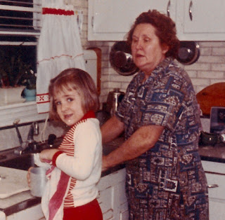 Sophie (Karvoius) Dixon and her granddaughter washing dishes, c. 1965.