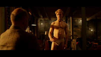 "Screenshot from ""Cucumber."" Henry and Freddie (standing) exchange more than glances."