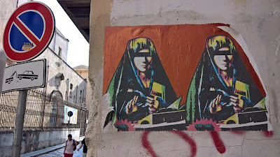 Palermo street art:  duplicated Virgin Mary mimics Antonello da Messina's Virgin Annunciate and is by Domenico Tirino aka Naf Mk.