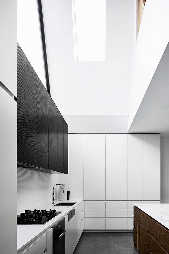 Contemporary kitchen with skylight. Design by Taylor Knights. Photo by Sharyn Cairns