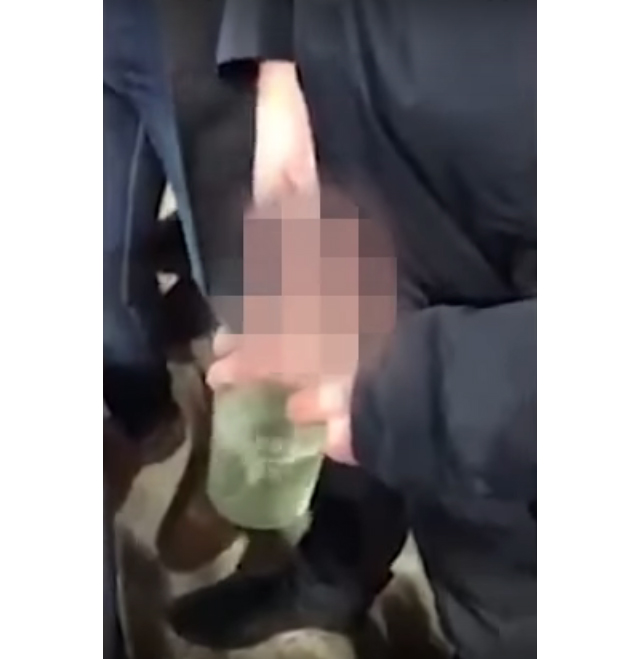 A Tottenham fan was filmed apparently throwing a pint of urine at West Ham supporters