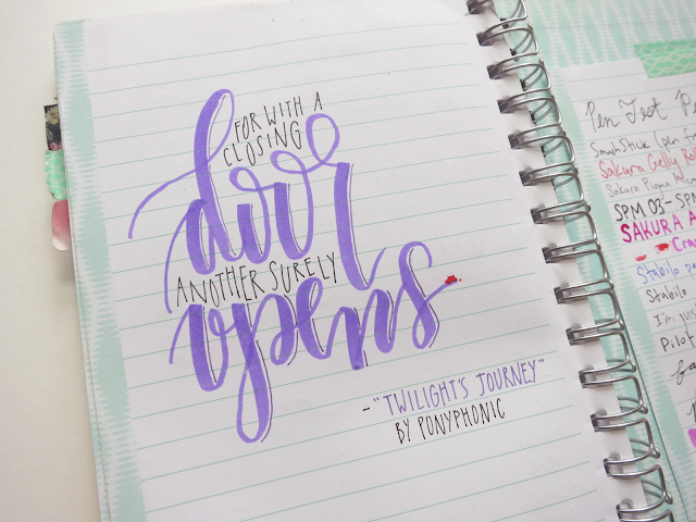 """a hand-lettered quote on the last page of my first bullet journal saying """"for with a closing door another surely opens"""""""