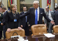 General Motors CEO Mary Barra, along with the chief executives of Ford and Fiat Chrysler, met with President Trump at the White House in January 2017 to discuss U.S. auto emissions standards. (Credit: Saul Loeb/Getty Images) Click to Enlarge.