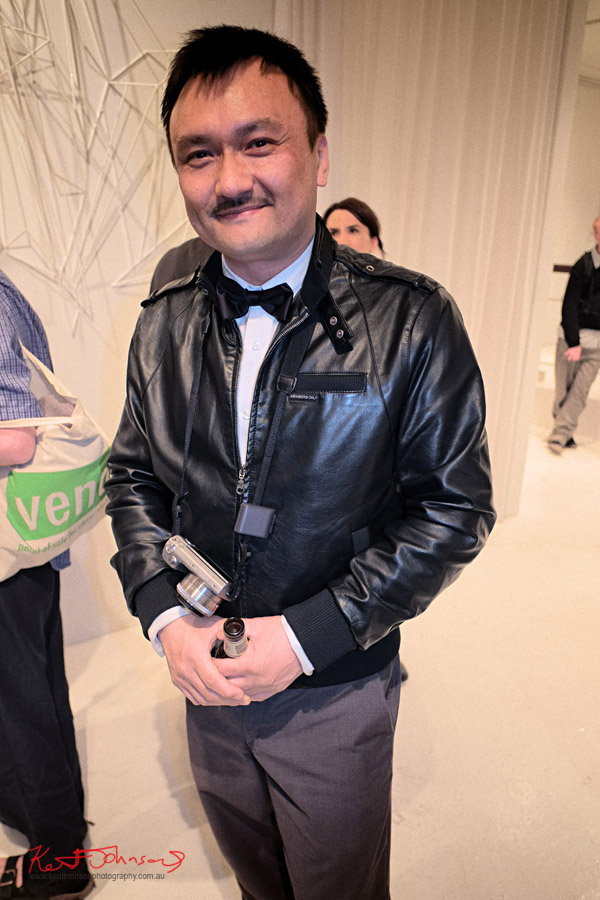 Mens Style, Black Bomber Jacket,  White shirt and black bow tie. Art opening.