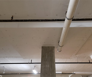 In Multi Use Buildings Where Parking Garages Are Built Below Residential Or Commercial E Insulating The Garage Ceiling Is Critical To Resident Comfort