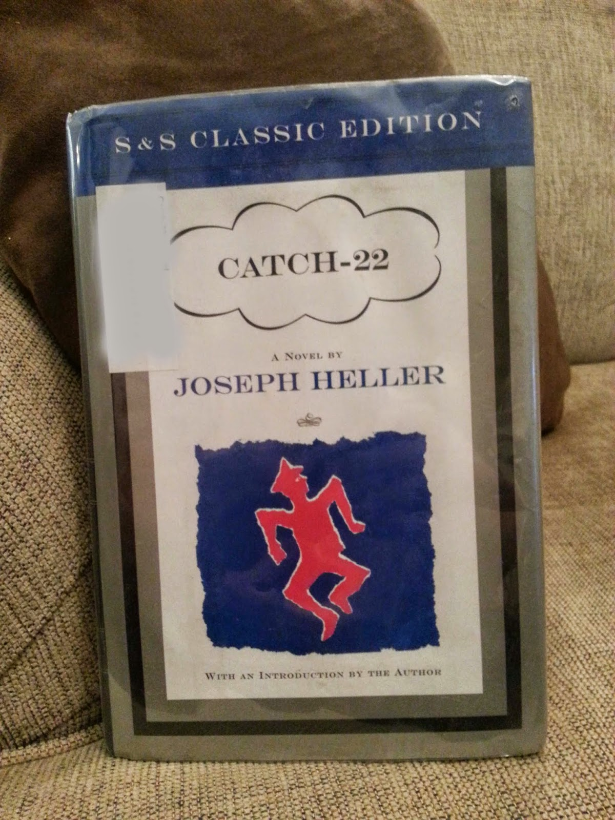 "catch 22 a comical satire by joseph heller ""that's some catch, that catch-22"" heller, joseph first edition of ""one of the most bitterly funny world war ii veterans appreciated its satire of the."