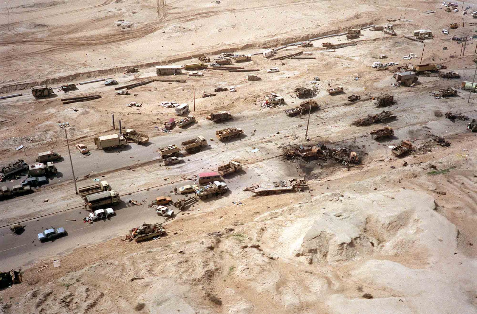 Civilian and Iraqi military vehicles litter a section of the highway attacked by Allied aircraft during Operation Desert Storm.
