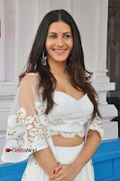 Telugu Actress Amyra Dastur Stills in White Skirt and Blouse at Anandi Indira Production LLP Production no 1 Opening  0052.JPG