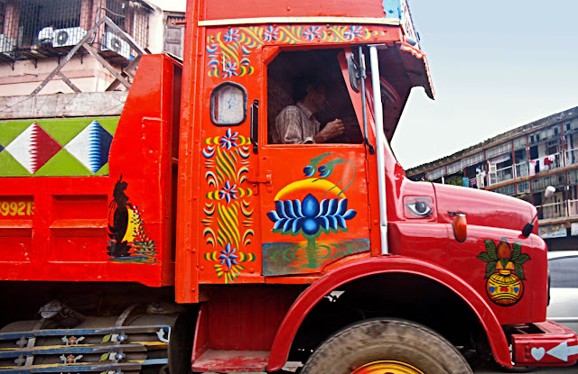 brightly painted truck with religous motifs