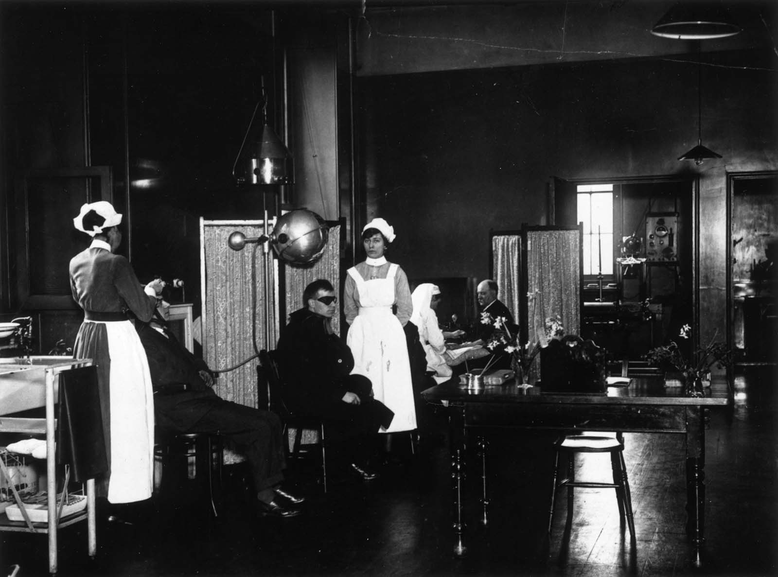 Patients receiving treatment in the Electrical Department of St George's Hospital, Hyde Park Corner, London. 1921.