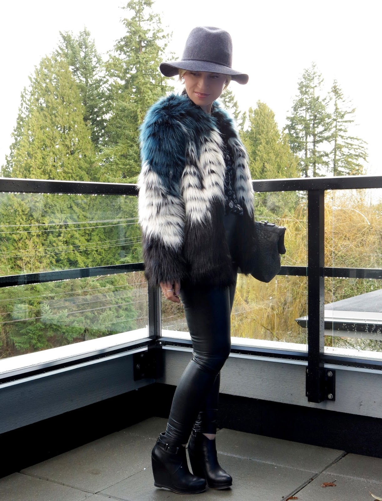 Fur baby:  faux-fur jacket with a patterned shirt, vegan leather leggings, wedge booties, and floppy hat