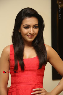Actress Catherine Tresa Latest Pos in Red Short Dress at Intex Air Conditioners Launch  0009.jpg