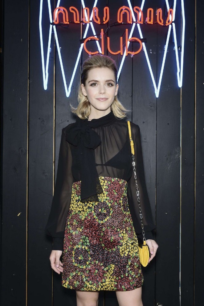 Kiernan Shipka shows off bra at the Miu Miu Fragrance and Croisiere Collection 2016 launch in Paris