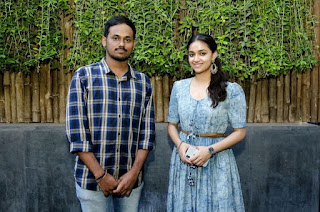 Keerthy Suresh in Blue Dress with Cute and Lovely Smile with a Fan 10