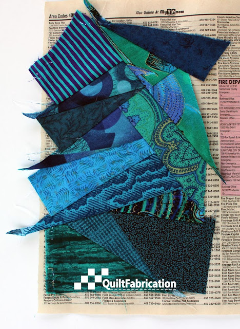 fabric scraps stitched to phone book paper