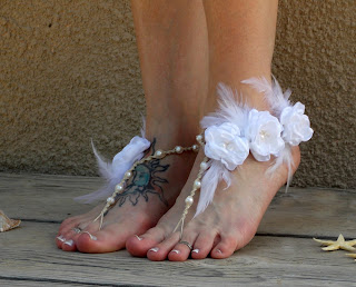 http://www.mojosfreespirit.com/collections/wedding-sandals/products/couture-barefoot-wedding-sandals-with-white-feather-accents-and-flowers
