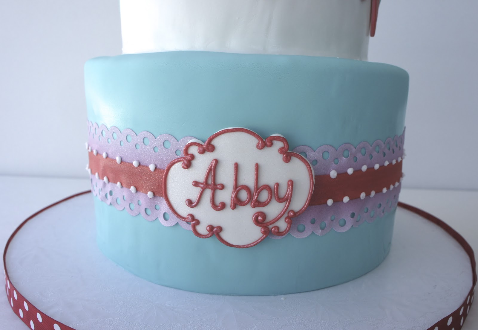 The Bottom Tier Has A Piece Of Edible Lace Ribbon Wrapped Around Whole Cake Then I Added Personalized Name Plate To Front