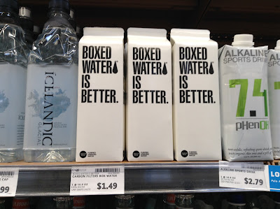 A photograph of boxed water sitting on the shelf