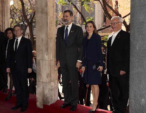 Queen Letizia wore Felipe Varela dress and coat, Felipe Varela clutch bag, Magrit Black Leather pumps, Bvlgari Aquamarine and Sapphire Gold Earrings