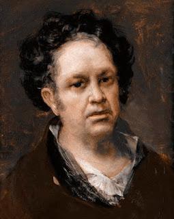 El pintor, a mediana edad, mira de frente, con el pelo encrespado y sayo marrón.