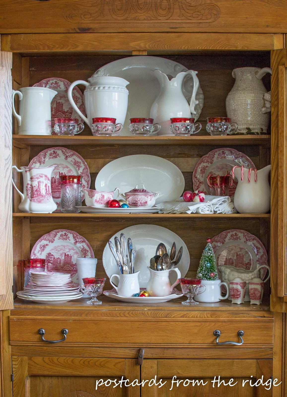 Ironstone pitchers and vintage dishes make a nice Christmas display