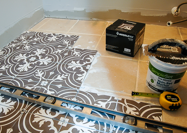 Installing patterned charcoal tile