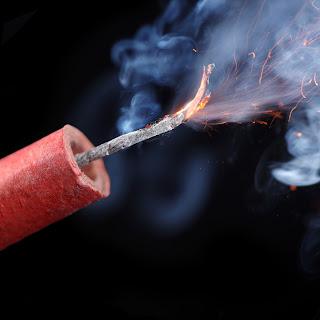 Lit firecracker.