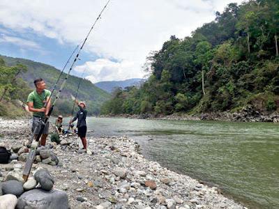 angler in teesta river